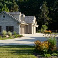 This stone addition onto an existing garage provides extra storage while blending into the existing home to create a unified look.