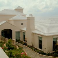 Not quite local, this complete home renovation and addition enabled an island family to enjoy life in Bermuda. Fresh stucco finishes with modern, care-free materials make for a unique finish.