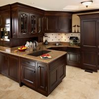 This pantry area of the kitchen makes use of the space with plenty of storage and counter area. The concealed appliances, using cabinet door fronts, keeps the area uncluttered.