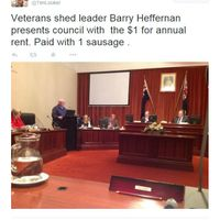 Barry - who leads the Shedders in running fundraising sausage sizzles - pays the Shed's annual peppercorn rent to the City of Holdfast Bay - in sausages!