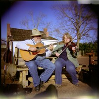 Musicians at Sweet Tooth Sugar Cane Festival, January 2014, Nacogdoches, Texas. Image made using unmodified Holga 120N camera.