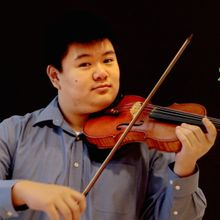 Violinist Jason Shu in a still image from the video accompanying 'Planetary Bands, Warming World'. Image by Elizabeth Giorgi.