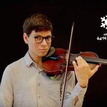 Violinist Julian Maddox in a still image from the video accompanying 'Planetary Bands, Warming World'. Image by Elizabeth Giorgi.