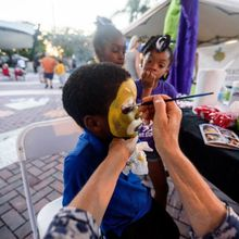 Kids enjoy face painting in the Kid's Corner at Sets in the West, May 14, 2015