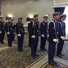 JROTC cadets performing the saber arches at the purple heart dinner