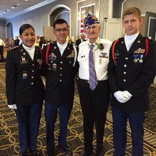 Cadets Gaytan(left) and Le(mid-left) accompanied by a cadet from Butler high school and a Purple Heart  recipient
