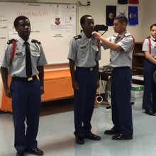 cadet Rankin receiving drill cord from commander