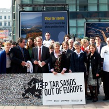 The Co-operative's 'Tarnished Earth' photo exhibition on tar sands in Brussels.