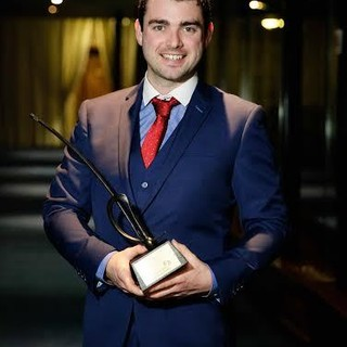 Mimergy CEO Niall Mimnagh receives Longford's 'Best Start Up' award at Ireland's Best Young Entrepreneur competition.