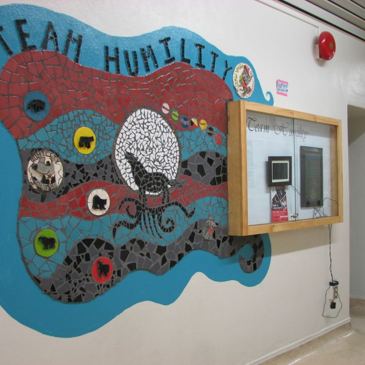 Team Humility mosaic mural.  The wolf.