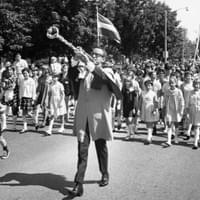 Bobby leads children through the streets in 1967.