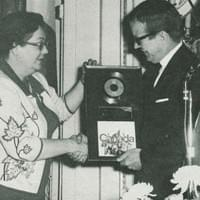 For the largest sale of a recording in Canadian history, Secretary of State Judy LaMarsh presents Bobby with a gold record
