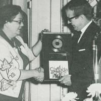 Bobby is presented with the award for the largest-selling recording in Canadian history by Sec. of State Judy LaMarsh