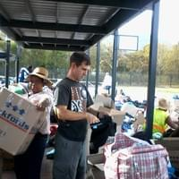 Todd sorting clothing donated to fire victims