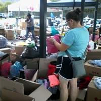 Jen sorting clothing donated to fire victims.