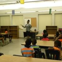Informing youth at Stephens Community Center in Little Rock, Arkansas on what the Federal Reserve Bank is