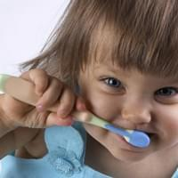 INFANT WITH TOOTHBRUSH