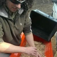 Andrew Fairney mixing seed before loading seedbox