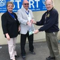 THe Deputy Mayor of Pateley Bridge and President Maurice of Harrogate Rotary make the draw for the winning raffle number.