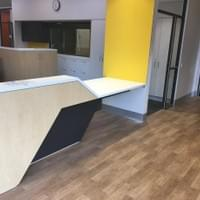 Reception counter with a lower section, with wheelchair user access under the counter