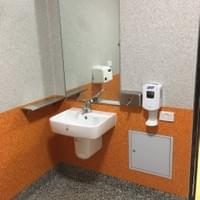 Accessible toilet wash hand basin with shelf and soap dispenser