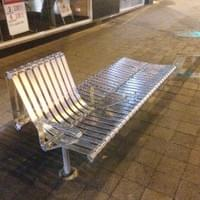 Stainless steel street furniture bench seat, with arm rest and back rest in one section