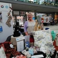 Louise with a selection of our crafted sale goods.