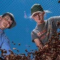 Andrew D. Brosig/Torrington Telegram Students Gave Plante, 15, left, of Wheatland and Jenny Manus, 16, of Torrington sort through small rocks screened from buckets of dirt dug nearby on June 13, 2018, at the Powars II Archeological Site in Sunrise, north of Guernsey. Two of a handful of students hired for the summer at the dig, Plante and Manus were searching for shards of chert that could indicate tool making by Paleo-Indians more than 13,000 years ago at the site.