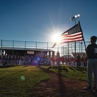 Andrew D. Brosig/Torrington Telegram Yankee Kai Fody holds the flag for the National Anthem to kick off the opening round of the Torrington City Little League Tournament at the Sports Complex in Torrington.