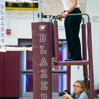 Andrew D. Brosig/Torrington Telegram Referee Debby Followell, top, and Torrington High School yearbook photographer Emily McGaugh, 15, follow a play from different angles during the Lady Blazer's volleyball match against Rawlins on Friday at Torrington High School.