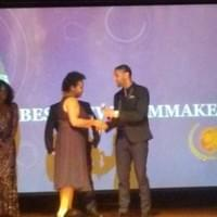 Director, Shanalyna Cp receives the Best New Filmmaker Award for Limbo at the Peachtree Village Film Festival