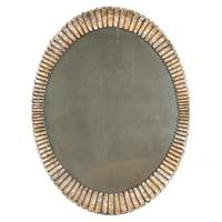 Carved wood mirror with a gold and silver patina. France, circa 1970
