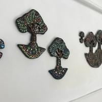 Studio display of mosaic trees.