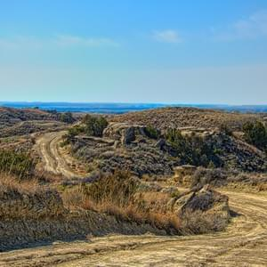 The dusty road into McGuire Creek with Fort Peck Lake in the distance.
