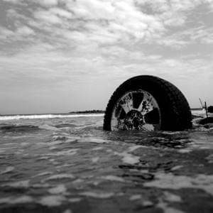 "A car remains on the shoreline in July, 2012; it washed away by the Japan's 2011 tsunami. Ulrich Beck (1992) suggests that a few major disasters of the last century are so large in scale they will remain in public memory indefinitely. Modernity, he posits, has created a ""risk society"" whereby the risks created are far greater than the ability to fix, cure, or nullify them."