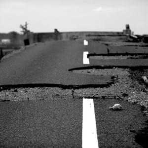 A road is left ravaged one year after the March, 2011 disaster. While the Prefecture of Fukushima is as large as 13,780km2 and the distance from the nuclear disaster site varies, 1.86 million residents of Fukushima had to face a newly imposed identity of being from the Prefecture of nuclear contamination and various implications that accompany it (Kwesell, 2018).