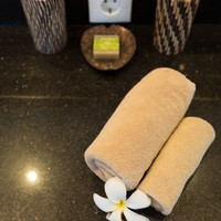 Nicely rolled up towels in luxury rental villa in Bali beach