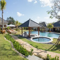 Swimming pool and bar area. Gardens and lawns