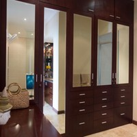 Full wardrobes and cabinets in a luxury, beach villa in South Bali