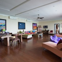 Living room with couches, furnishings and Balinese artwork