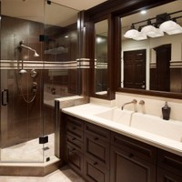 Simplicity in colour and style draw attention to a large built-in shower and personalized lavatory sink accomodating more than one occupant.