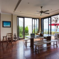 Dining room and kitchen with ocean view and privacy in a luxury 3 bedroom villa in Bali
