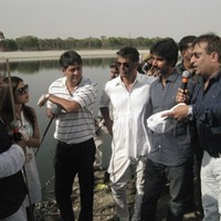 Mr. Rajesh Mittal, MD, GPWM speaking at the launch of NDTV Greenathon program on the banks of Yamuna river in Agra on April 9, 2012. Also, seen here are bollywood actors Ms. Priyanka Chopra and Mr. Milind Soman, NDTV CEO Mr. Vikram Chandra, Environmentalist Mr. Vimlendu Jha and UP Minister Mr. Abhishek Mishra.