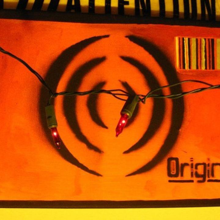 Black spray-paint through cut stencil of Origin logo