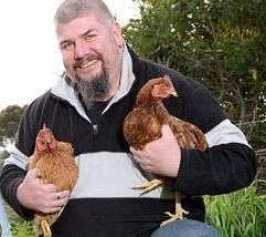 rick duke holding two chickens