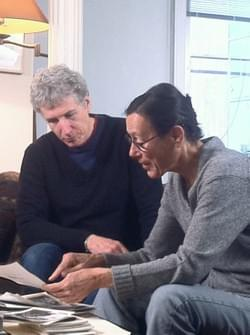 Jack and Yvonne looking at stills from her films