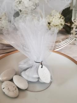 Organza wrapped almond dragées with a handmade porcelain HAPPY charm