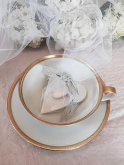 Antique lace embossed handmade porcelain heart dragée/ring dish wrapped in tulle with a cotton lace ribbon