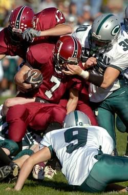Manchester Central's Tim Sowa gouges through Concord's Blake Wintle (7) face mask during the Tide's 28-13 homecoming loss to the Little Green.