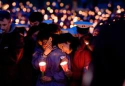 Thousands of people gather to take part in the mass candlelight vigil at Virginia Tech one day after a gunman opened fire on campus killing 32 people before turning the gun on himself.